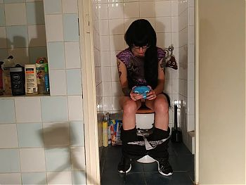 Sexy goth teen pees while playing with her phone pt2 HD